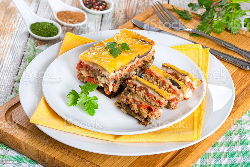 portion of delicious moussaka decorated with parsley stock photo