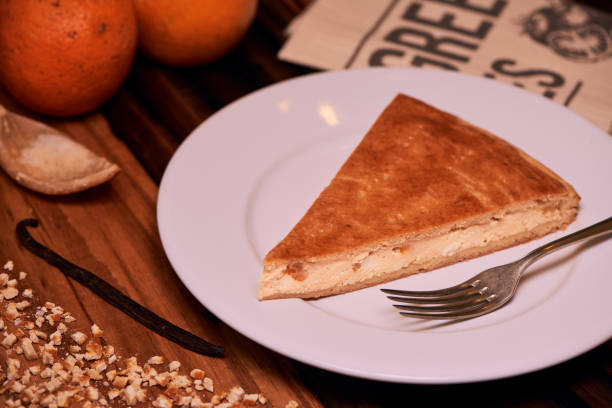 Portion of Homemade Italian Ricotta Cheesecake with chopped candied orange peels. stock photo