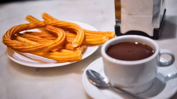 Portion of hot Madrid Churros served on a table. stock photo