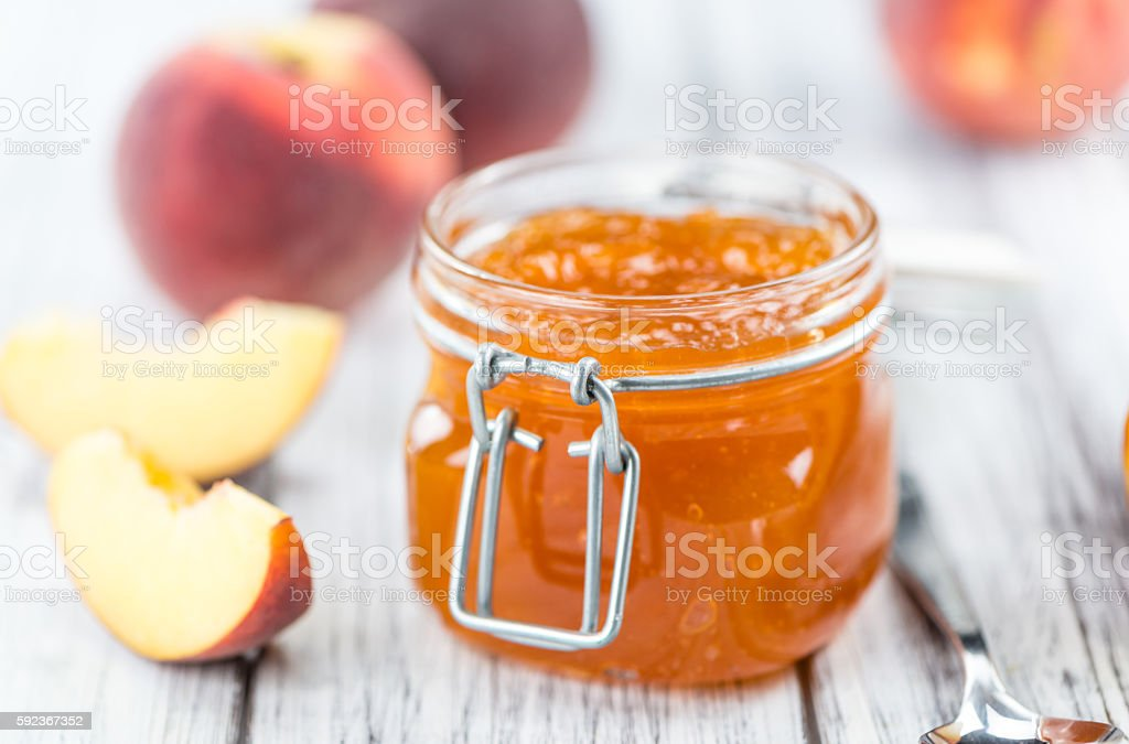 Portion of Peach Jam (close-up shot) stock photo