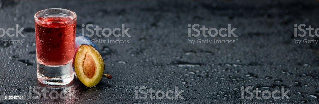 Portion of Plum Liqueur on a slate slab stock photo