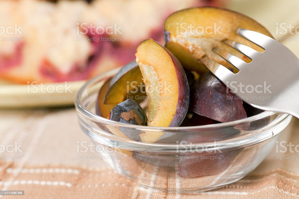 Portion of plums in bowl royalty-free stock photo