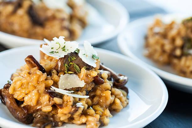 portion of risotto rice with fungi. - yabani mantar stok fotoğraflar ve resimler