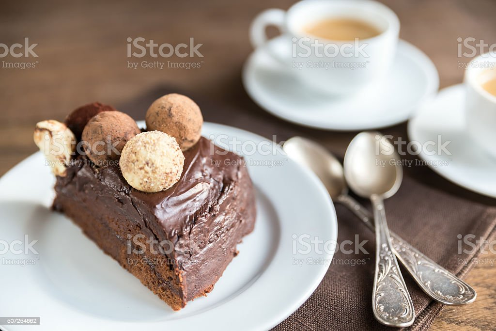Portion of Sacher torte with two cups of coffee stock photo
