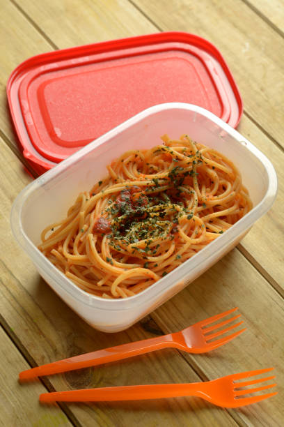 portion of spaghetti in plastic container - closeup - playpen stock pictures, royalty-free photos & images