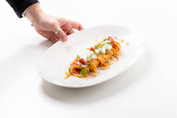 Portion of spaghetti with tomato and burrata cheese on white background - foto stock