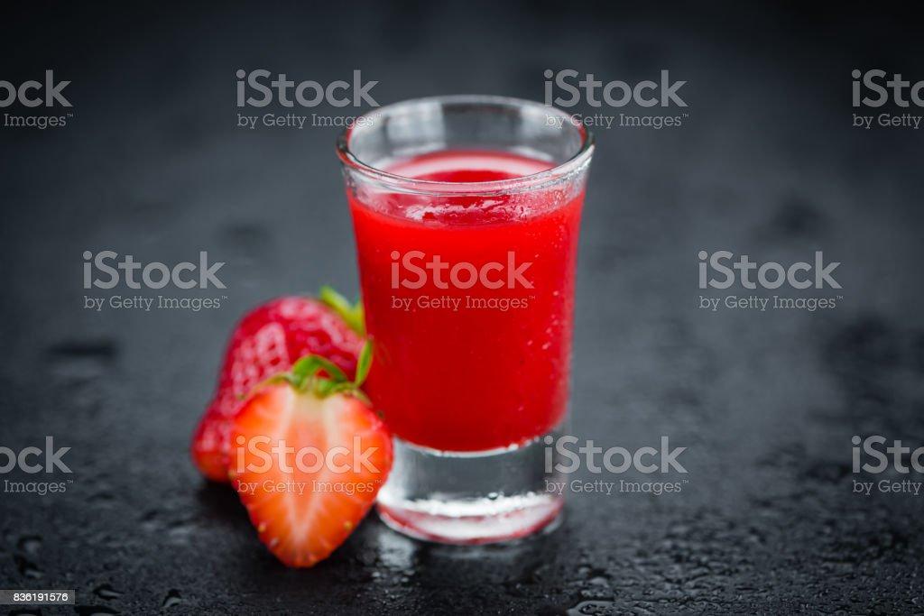Portion of Strawberry liqueur on a slate slab stock photo