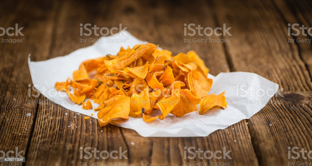 Portion of Sweet Potato Chips , selective focus stock photo