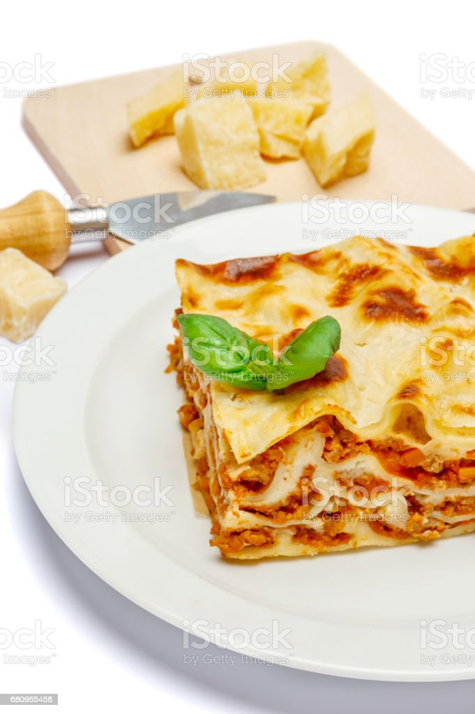 Portion of tasty lasagna isolated on white royalty-free stock photo