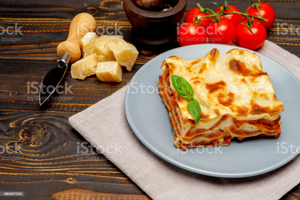 Portion of tasty lasagna on wooden backgound foto de stock royalty-free
