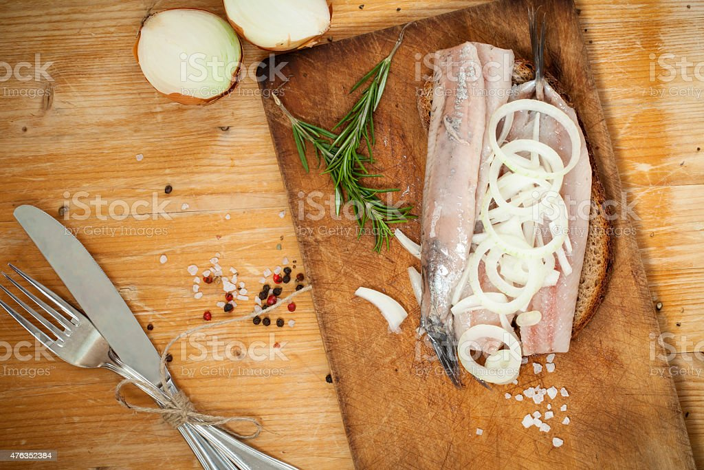 Portion of typical Dutch herring on bread stock photo