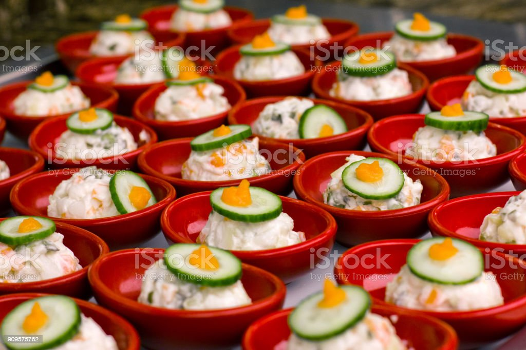 Portion Salad With Mayonnaise In A Red Plate Decorated With Piece Of