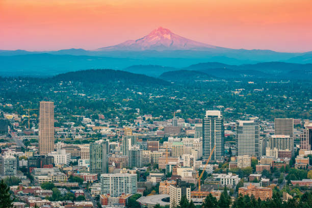 Portland and Mt Hood in Oregon USA at sunset Stock photograph of  downtown Portland and Mt Hood in Oregon USA at sunset mt hood stock pictures, royalty-free photos & images