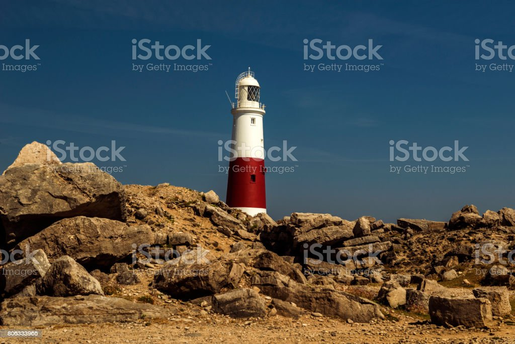 Portland Bill Lighthouse - Blue skies and Quarries rocks stock photo