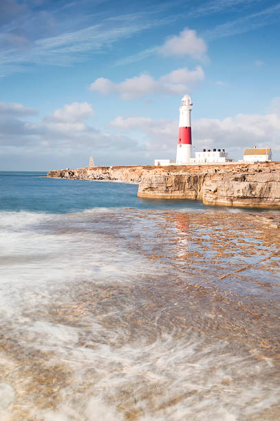 portland bill reflections - pulpit rock dorset stock photos and pictures