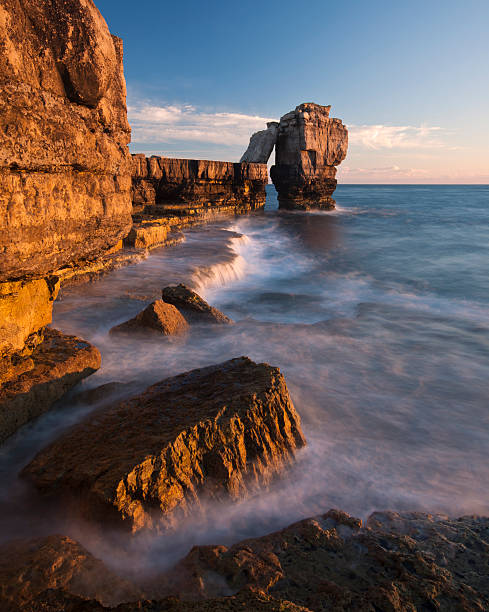 portland bill sunset - pulpit rock dorset stock photos and pictures