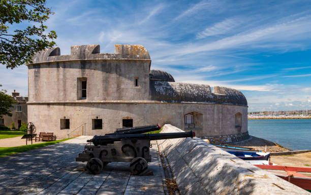 Portland Castle and canons pointing out to sea stock photo