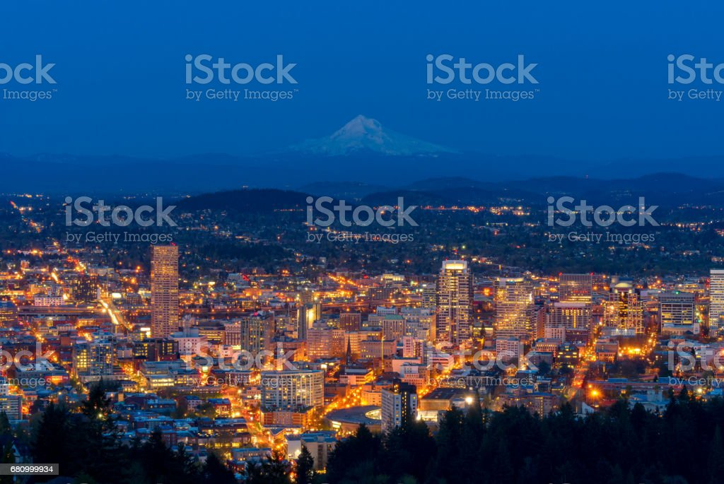 Portland city with mount Hood in a background during dusk. stock photo