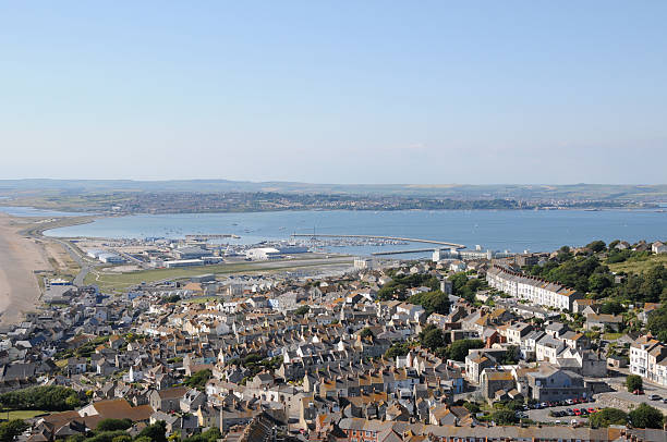 portland harbour - weymouth stock photos and pictures