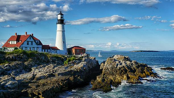 Portland Head Light House, Cape Elizabeth, Sailboat, Coastal Maine stock photo
