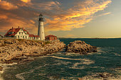 istock Portland Head Light with Rocky Cliffs, Ocean Surf and Beautiful Sunset Sky. 1297220451