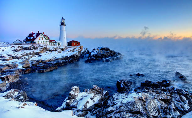 portland head lighthouse arctic sea smoke - rocky coastline stock pictures, royalty-free photos & images