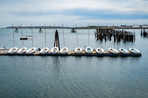 Portland, Maine, view of docking sailboat on blue water of casco bay
