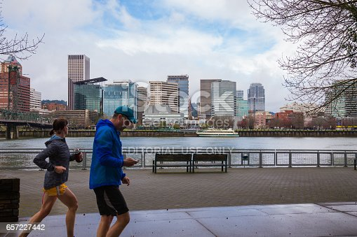 Portland, DeepMeta.Shared.Country: Runners and walkers make use of the waterfront trail system in downtown Portland Oregon.