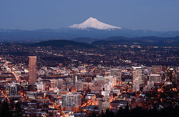Portland Oregon City lights of Portland with Mt Hood in the distance.Portland Lightbox mt hood stock pictures, royalty-free photos & images