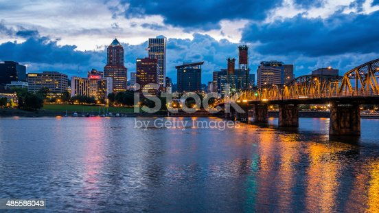 Colorful lights reflecting off the Willamette River in Downtown Portland, Oregon