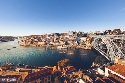 oporto city with douro river and dom luiz bridge under blue sky, portugal.