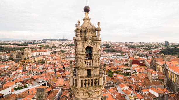 Porto cityscape with famous bell tower of Clerigos Church, Portugal aerial view Porto cityscape with famous bell tower of Clerigos Church, Portugal clergy stock pictures, royalty-free photos & images