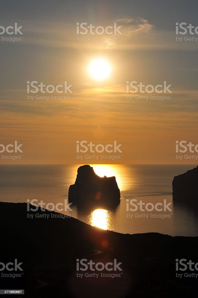 Porto Flavia, Masua, Sardinia, Italy: silhouette of Sugar Loaf islet royalty-free stock photo