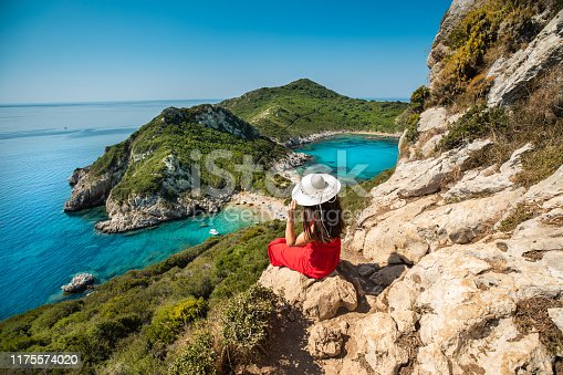 Young woman enjoy the holiday view of Porto Timoni, Corfu in Greece.