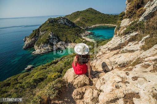 Young woman enjoy the holiday view of Porto Timoni, Corfu in Greece.