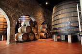 Old fashioned Porto wine cellar with wooden barrels in Porto, Portugal