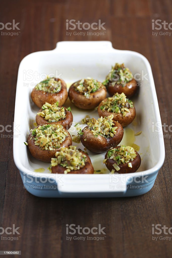 Portobello or button mushrooms filled with cheese and spices royalty-free stock photo