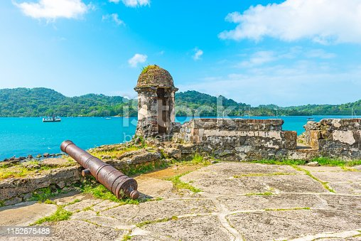 Ancient Spanish fortress with shooting tower and cannon by the Caribbean Sea to protect the custom from pirate attacks, Portobelo, Panama. Also a known place for it is where Christopher Columbus saw the Central America for the first time during his fourth voyage.