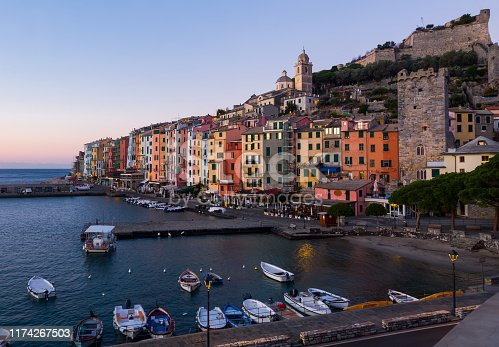 Fortified city of Portovenere on extreme southern peninsula of La Spezia Bay at sunset, Italy