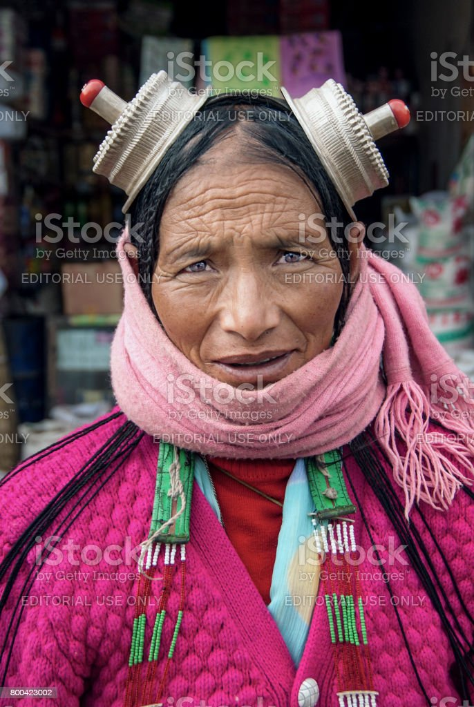 Portrail of senior Khampa woman Khampa people is the natives of Kham a historical region in East-Tibet. stock photo