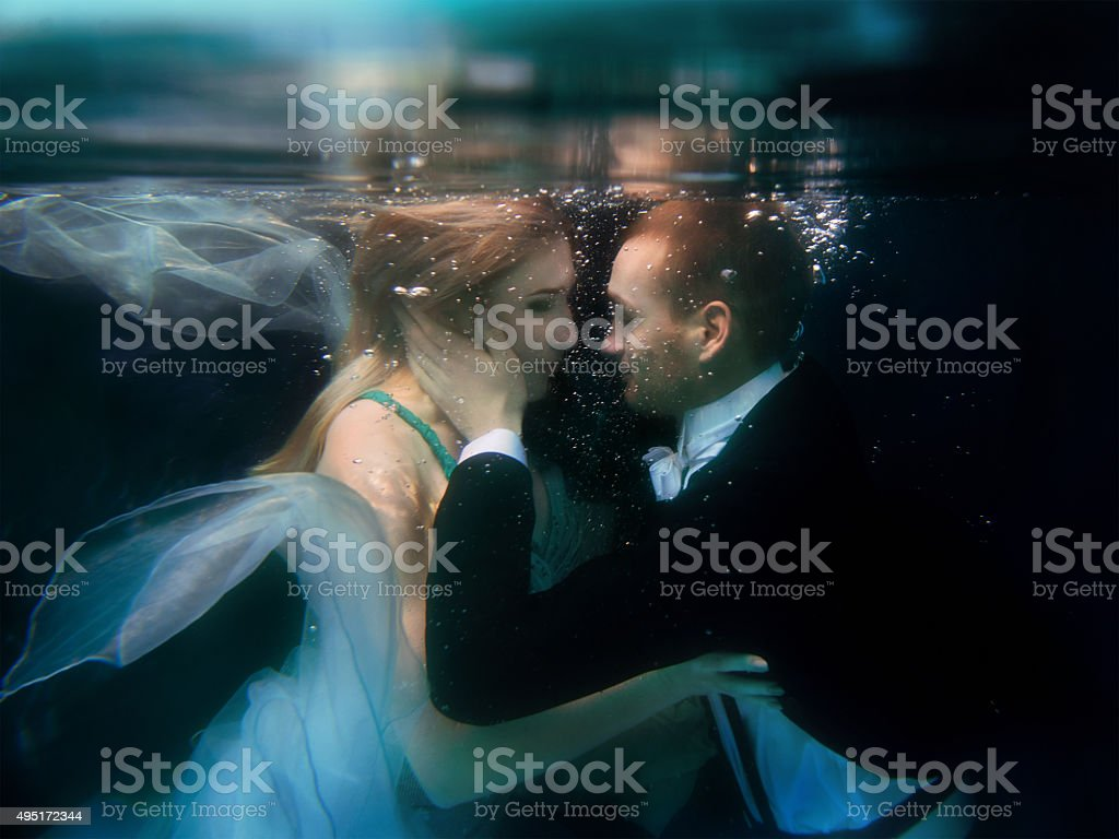 portrair of young dancing couple underwater stock photo