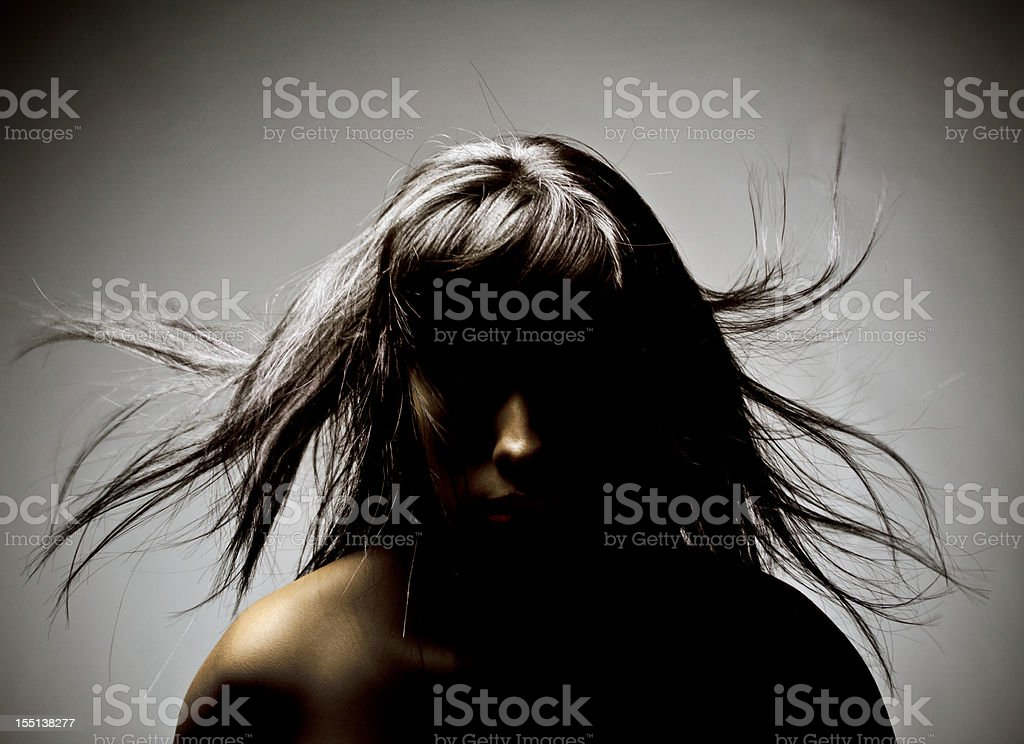 Portrait 1 of mysterious woman in shadow with flying hair royalty-free stock photo