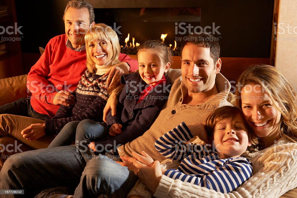 Portrait 3 generation family at home by firelight royalty-free stock photo