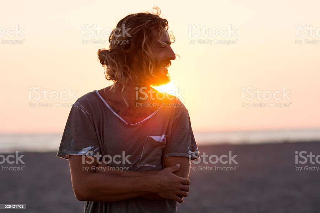 Portrait and sunset at the beach stock photo