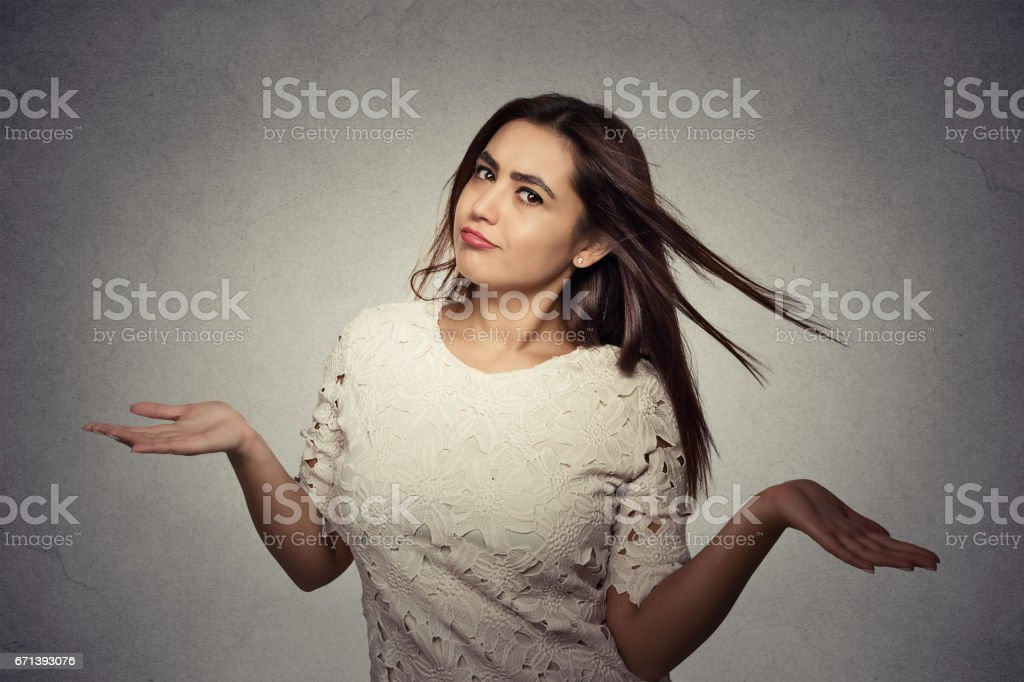 Portrait annoyed looking woman arms out shrugs shoulders who cares so what stock photo
