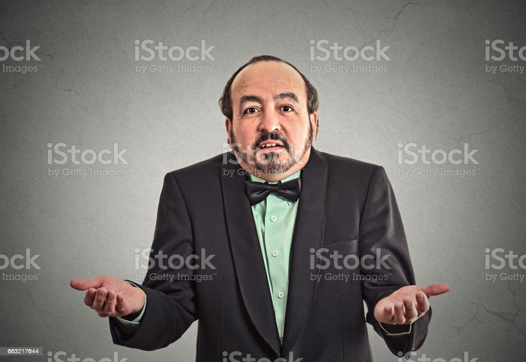 Portrait arrogant clueless middle aged business man arms out asking what's problem stock photo