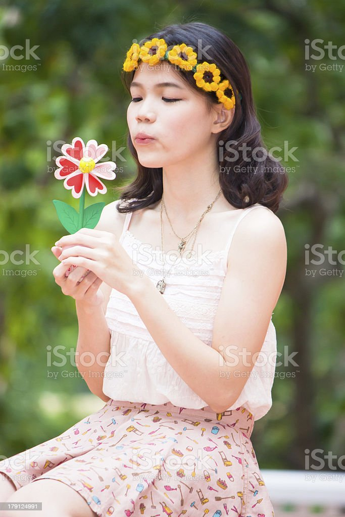 Portrait asian girl with toy flower stock photo