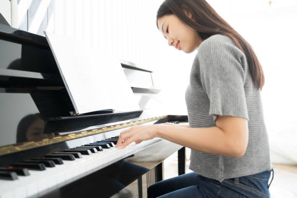 1,002 Beautiful Female Pianist Sitting Next To Her Piano Stock Photos,  Pictures & Royalty-Free Images - iStock