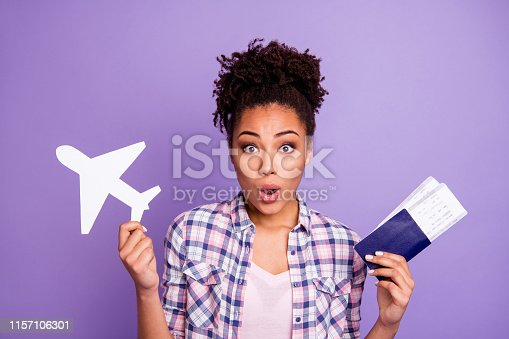 Portrait astonished cute lady impressed unbelievable unexpected news flight tour free time abroad open mouth wow wonder beautiful, top-knot isolated wear stylish checked shirt purple background