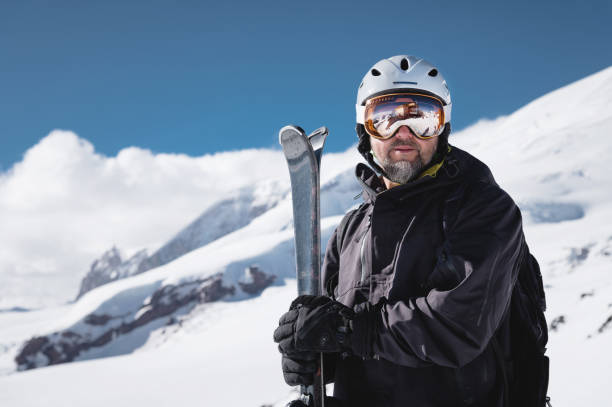 Portrait athlete skier in helmet and ski mask stock photo